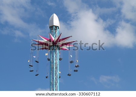 The Swinging Chair Seats of a High Fun Fair Ride. - stock photo