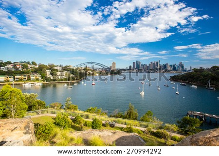 The Sydney CBD and surrounding harbour over Berrys Bay, on a clear summer day on February 8th 2015. - stock photo