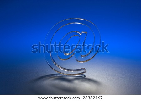 The Symbol e-mail on turn blue the background. - stock photo