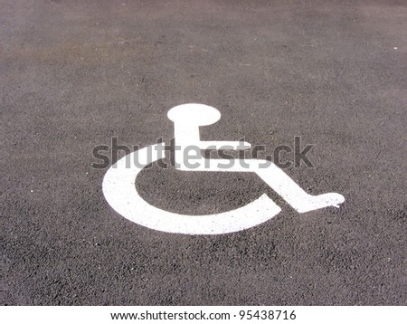 the symbol handicapped on a parking space - stock photo