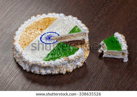 The symbol of war and separatism: a cake with a picture of the flag of India is broken into pieces - stock photo