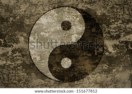 The symbols of yin and yang on grange background texture - stock photo