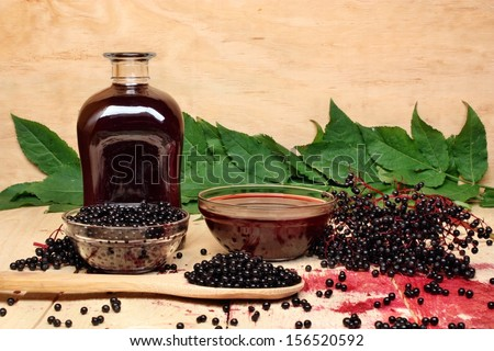The syrup of black elderberry - stock photo
