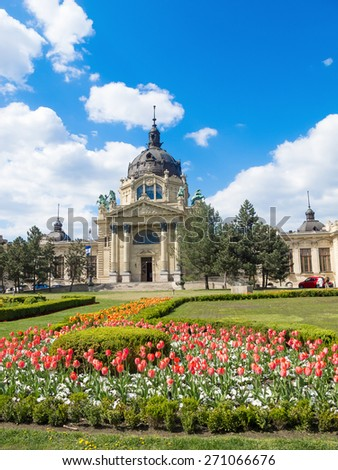 The Szechenyi Bath in Budapest, Hungary with a flower garden in the front. - stock photo