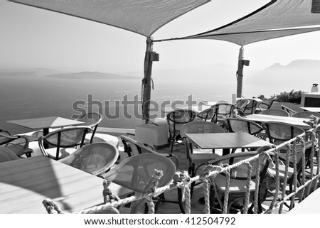 the table in santorini, greece, old restaurant chair and summer - stock photo