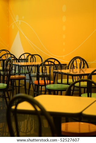 The tables and chairs of fast food store - stock photo