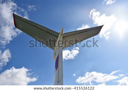 The tail of the plane against the sky and sunlight (successful flight, success, achievement, anticipation, journey - concept) - stock photo