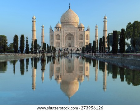 The Taj Mahal at dawn- a mausoleum at Agra in northern India. Built by the Mogul emperor Shah Jahan (1592 to 1666) in memory of his favorite wife. Completed circa 1649. - stock photo