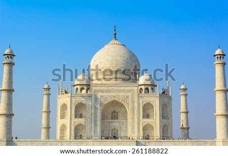 "The Taj Mahal from Persian and Arabic,""crown of palaces"", pronounced also ""the Taj"" is a white marble mausoleum located in Agra, Uttar Pradesh, India. The Taj Mahal is a UNESCO World Heritage Site - stock photo"