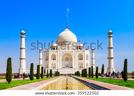 The Taj Mahal is a white marble mausoleum located in the city of Agra, India. Taj Mahal is one of Seven Wonders of the World. - stock photo