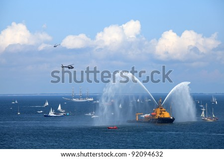 The Tall Ships Races - Firefighter Vessel Show. - stock photo