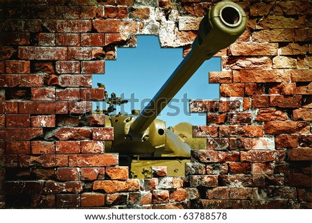 The tank breaking a wall - stock photo