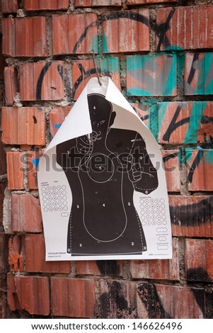 The target for shooting at a silhouette of a man with gun - stock photo