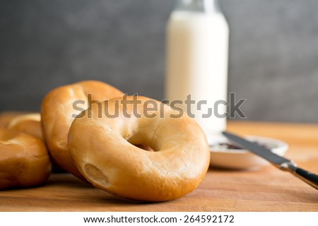 the tasty bagels on kitchen table - stock photo