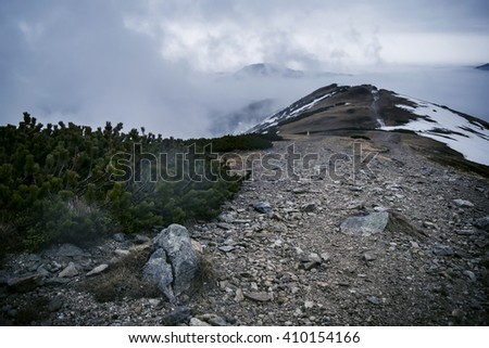The Tatra mountains with snow. Natural panorama photo of a mountains in early spring. Misty mountains