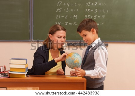 The teacher explains the lesson in class. - stock photo