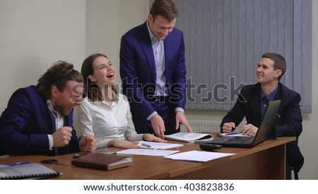 The team of young businesspeople. Rejoice success. In the office. The plan is executed. The smooth movement of the camera - stock photo