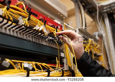 The technician attaching fiber optic on the telecom site - stock photo