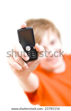 The teenager in an orange T-shirt holds a cellular telephone