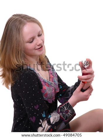 The teenager tries parfum - stock photo