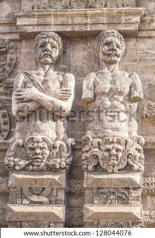 The telamons carved in the new door of Palermo (Italy)