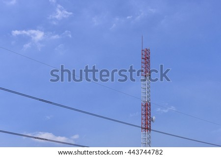 The tele-communucation antenna tower building with the blue sky. - stock photo