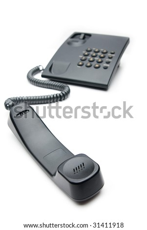 The telephone tube lays on a background of a telephone set on a white background - stock photo