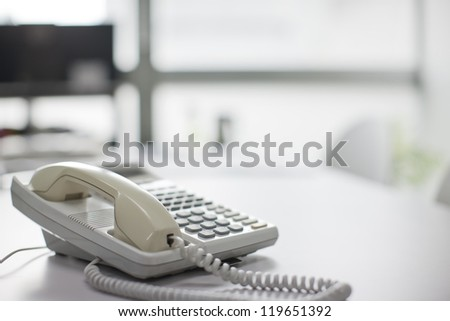The telephone which there is on a table