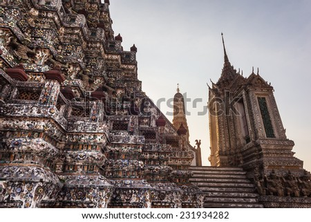 The Temple of Dawn Wat Arun and a beautiful blue sky in Bangkok, Thailand - stock photo