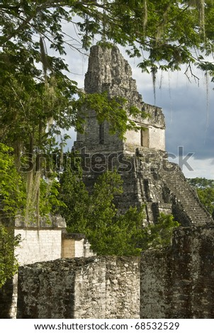 The temple of Tikal in late afternoon sunlight. - stock photo