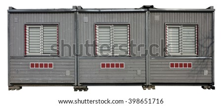The temporary shed of builders consists of three sections. Blocks are painted with gray paint and there are windows with blinds. Isolated