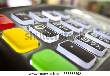 The terminal for cashless payment money bank credit card with glowing buttons and bright multicolored cancel buttons - stock photo