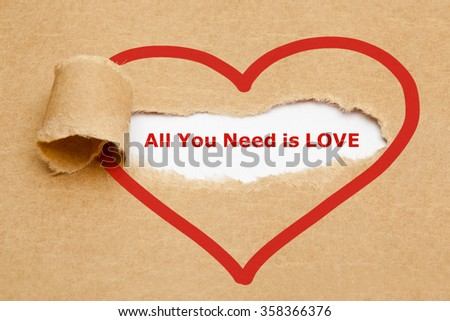 The text All You Need is Love appearing behind torn brown paper.  - stock photo