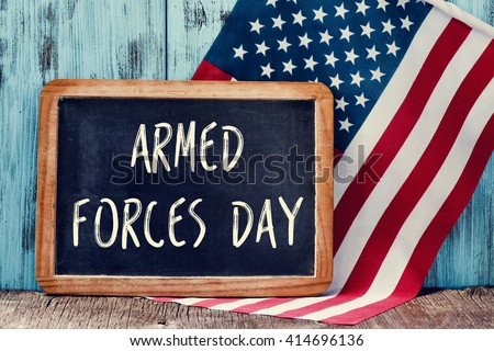 the text armed forces day written in a chalkboard and a flag of the United States, on a rustic wooden background - stock photo