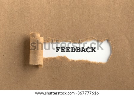 The text FEEDBACK behind torn brown paper - stock photo
