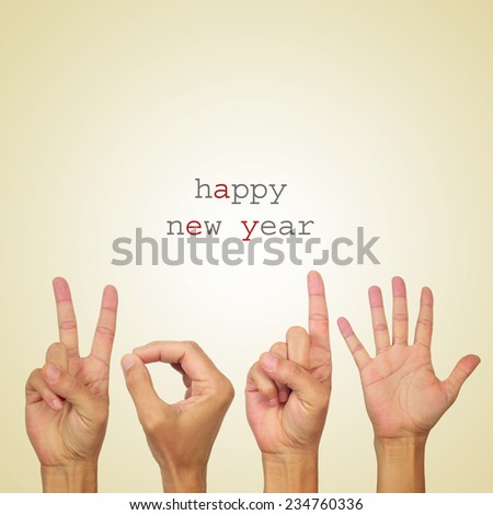 the text happy new year and man hands forming the number 2015 on a beige background - stock photo