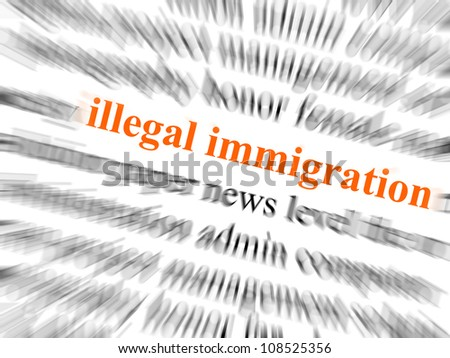 The text illegal immigration in focus. Surrounding text blurred with zoom effect. - stock photo