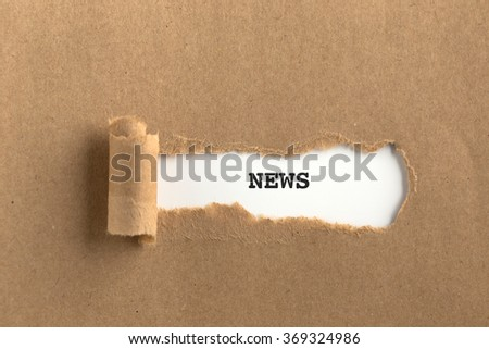 The text NEWS behind torn brown paper - stock photo