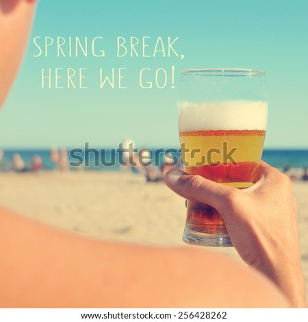 the text spring break, here we go written on a blurred image of a young man having a beer on the beach