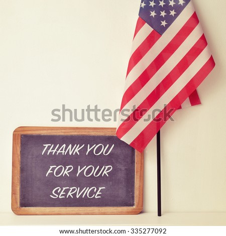 the text thank you for your service written in a chalkboard and a flag of the United States - stock photo