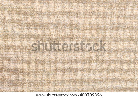 the texture background of the carpet,the carpet texture with the clean condition.The light brown carpet texture background in the meeting room.Close up of the carpet texture background. - stock photo