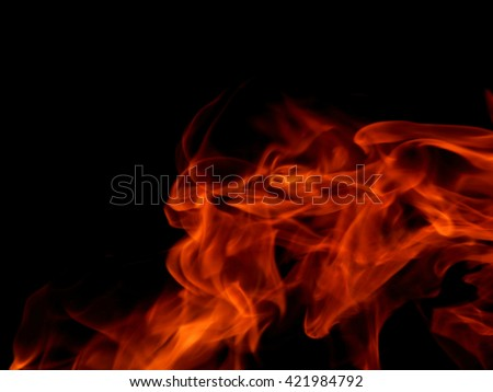 The texture of a flame of fire on a black background - stock photo