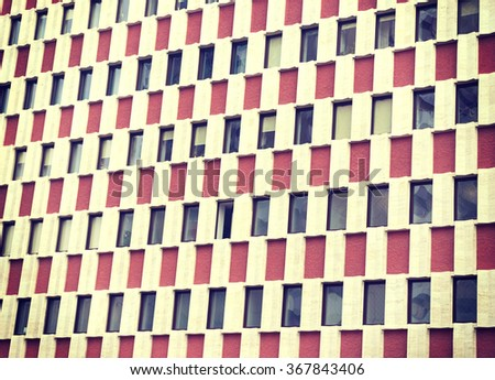 The texture of a multistory building window wall - stock photo