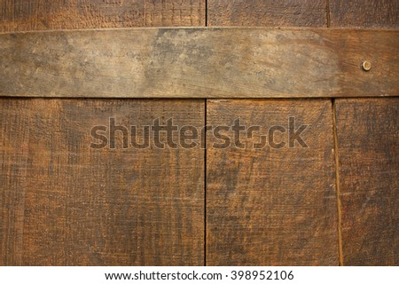 The texture of an old wooden (wine or beer) barrel with a stave - stock photo