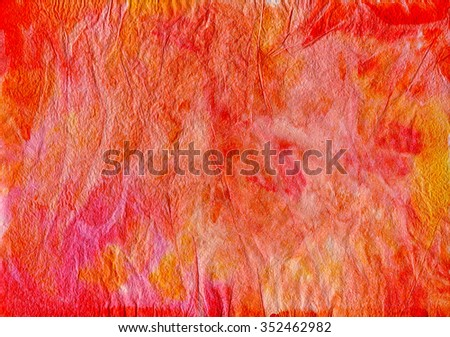 The texture of crumpled paper with spots of red and yellow paint. - stock photo