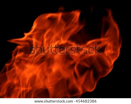 The texture of fire on a black background - stock photo