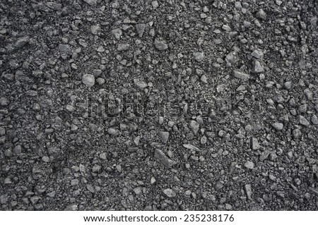 The texture of fresh asphalt lined close up. Pavement background                   - stock photo
