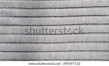The texture of gray knitted fabric with lines - stock photo