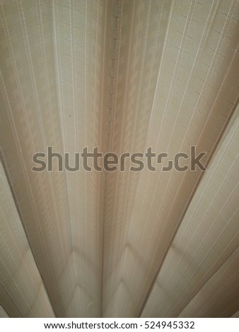 the texture of light brown curtain