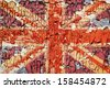 The texture of old paint, crackles with the image of the Union Jack. - stock